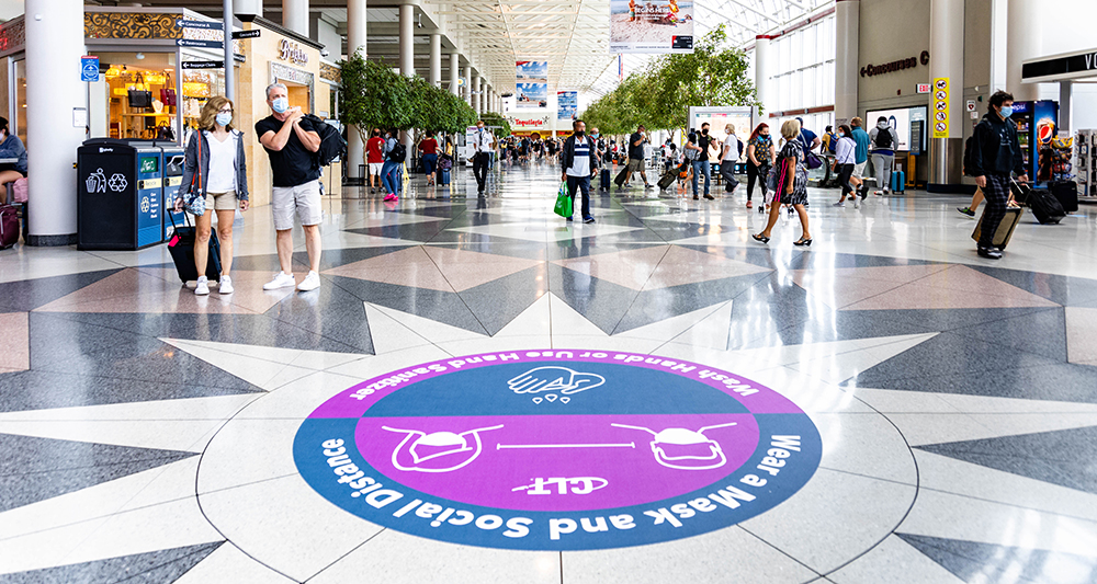 COVID Signs Add to Airports' Wayfinding Journey